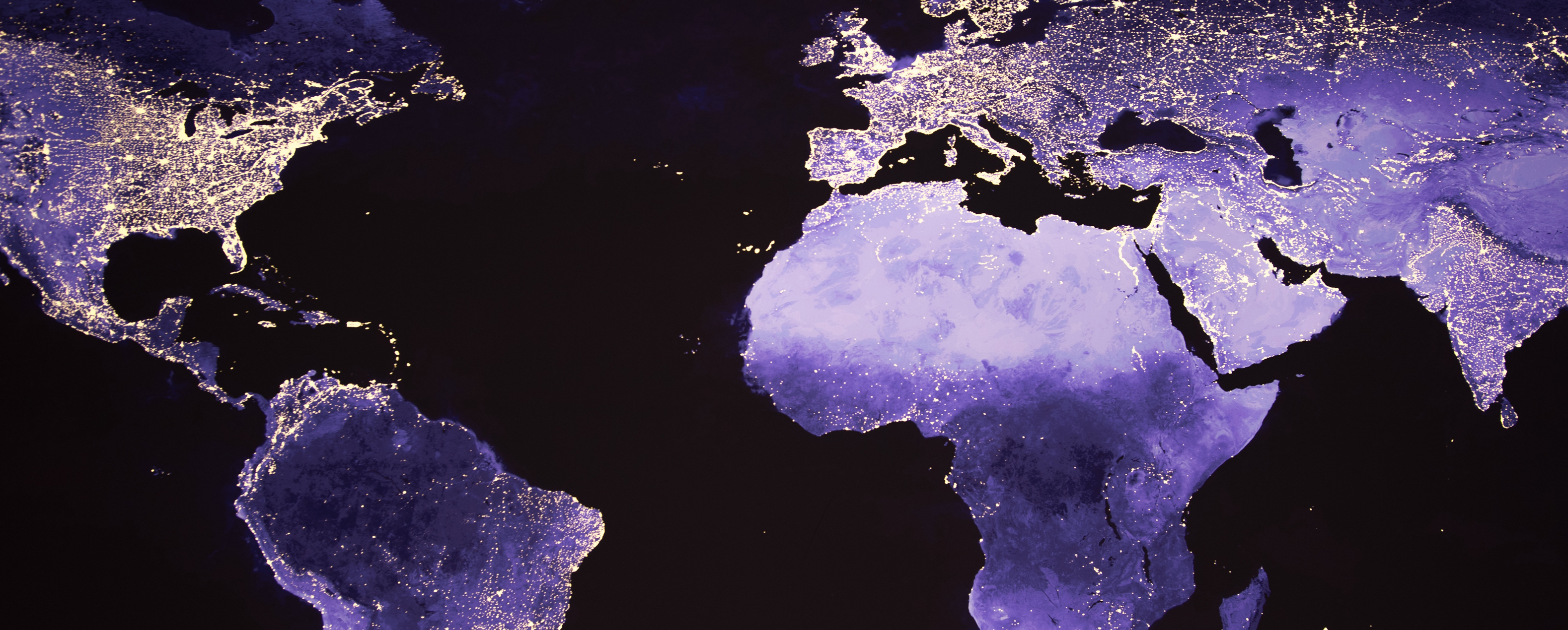 World map standing out in purple with glowing areas of land