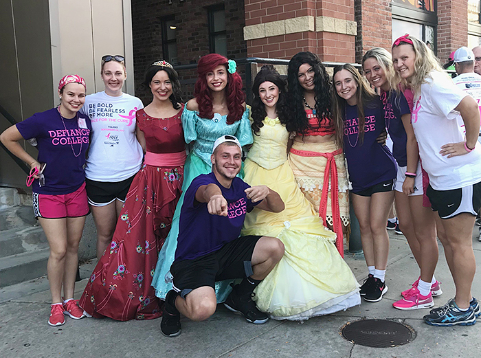 Service Leaders with costume Disney princesses